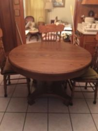 ROUND ANTIQUE  OAK TABLE AND  CHAIRS