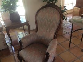 Antique carved arm chair with Ikat upholstery