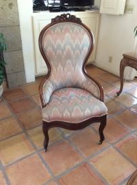 Antique carved side chair with ikat upholstery