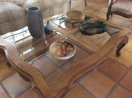 Wood and glass coffee table, has matching side tables
