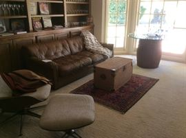 Leather sofa, wicker trunk, Persian rug, MCM CHAIR