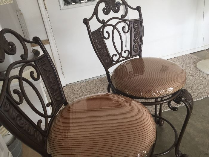 Two upholstered and metal bar stools