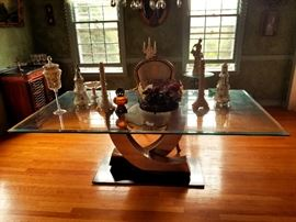 Statement chrome and glass dining table.