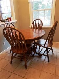 Oak Pedestal Dining Table & Four Chairs: http://www.ctonlineauctions.com/detail.asp?id=763045