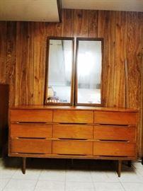 Mid-Century Modern Walnut Double Dresser:      http://www.ctonlineauctions.com/detail.asp?id=764069