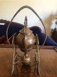 Brass antique teapot on bunson burner stand