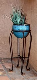 Outdoor rustic wrought iron plant stand with turquois pot and cactus.  There are two available. Second is very similar.