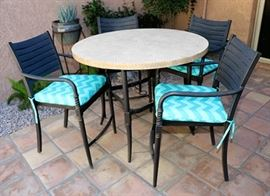 5-piece patio dining set with round stone table, 4 chairs with cushions.  Pot & plant stand in background is available.
