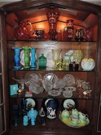 Left Curio Cabinet contents on top.