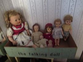Doll include Tama the talking doll, two in photo are newer dolls, the small baby doll has a bisque head and cloth body,  two dolls in the middle are 1940's dolls