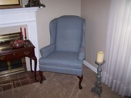 ONE OF A PAIR OF WING CHAIRS & PILLAR CANDLESTICK