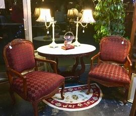 Pair of Burgandy and Gold Chairs with carved top and trim