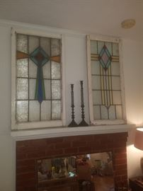 Architectural salvage: antique stained glass windows between 3 and 4 feet tall. Cast iron candlesticks.