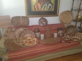 Baskets, wooden masks, large leaf pottery bowl (sofa not for sale)