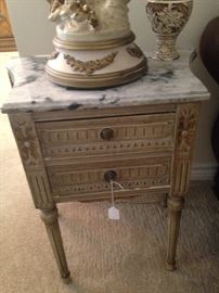 One of two marble top end tables