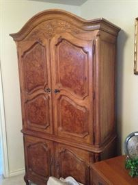 This beautiful armoire provides an abundance of clothing storage.