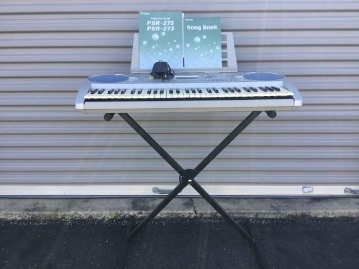 Yamaha Key Board with Stand, Song Books and Adapter  https://ctbids.com/#!/description/share/53175