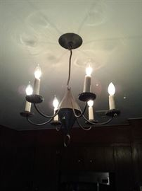 Pierced tin chandelier