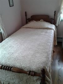One of a pair of hand made bed covers