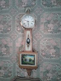 Reverse painted banjo clock with portrait of Lee