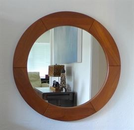 "31-inch round, 1-inch thick, solid teak mirror by Pedersen and Hansen Viby J.  Mid-Century Modern  Mounts flush against wall Made in Denmark VIBY J. Made In Denmark"", displayed in blue lettering on ""gold label"" on back."