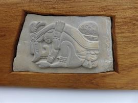 Wall plaque - hand carved stone, reproduction of Mayan carving.  Not a mold.  mounted in teak wood