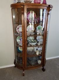 One of those lovely Curved Glass Curio Cabinets...not too big and not too small.