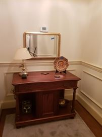 Hall table; mirror and brass lamp