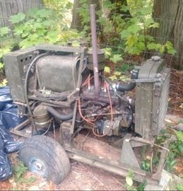 Us military generator from the Korean War era: Flat head, 4 cylinder gas engine with airplane tires, and gas can. .