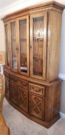 Four door china cabinet with enclosed storage below
