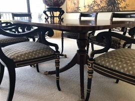 Another view of black and gold dining chairs