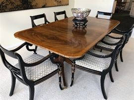 Double-pedestal burled walnut dining table with 8 black arm chairs with gold leaf accents - ALL in excellent condition