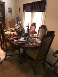 Matching table with 6 chairs, and two leaves