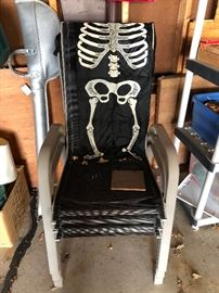 Vintage Skelton costume for children and stacking outdoor chairs, Fishing poles, Plastic shelving