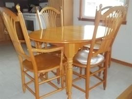 excellent dining table and chairs from The Sawmill in Wyandotte