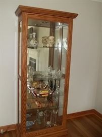 Amish made curio cabinet with front sliding door for easy access