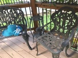 Metal iron set includes a settee, two armchairs and a pair of small plant stands