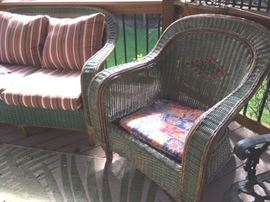 Two-tone wicker love seat and armchair; matches highback armchair and side table in previous photo.