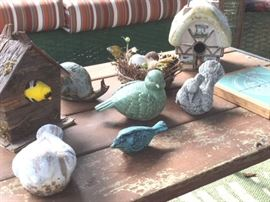 Various whimsical bird and snail sculptures in metal and pottery, also decor bird houses