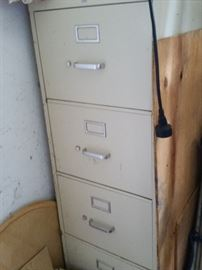 Two 4-Drawer File Cabinets, one beige and one black