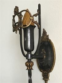 Rubbed bronze sconces. Nouveau  aesthetic.