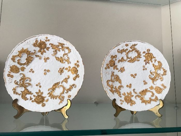 Meissen plates, in white heavy relief with gilt, as pair.