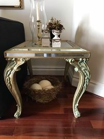 Mirrored and foliate motif endtables, pair with ostrich eggs in nest.