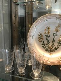 Flora Danica dinner plate, Royal Copenhagen with Michelangelo pattern by Baccarat, full suite of cordial, liquor, wine and water glasses.