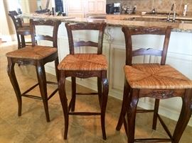 There are 5 rush seat barstools