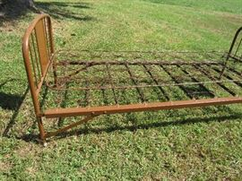One of 3 metal beds we've found so far: this one is a clever old twin fold-away