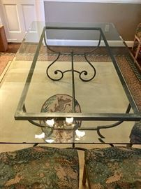 French Country Living Glass top table with steel and brass ornate base