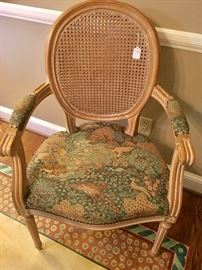 Six cane chairs (2 arm chairs) with animal print fabric