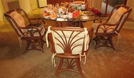 Rattan glass top dining table and four chairs.