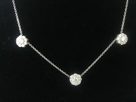 "18KT WHITE GOLD AND DIAMOND FLEURETTE 3-FLOWER NECKLACE: In excellent condition. Comes with beautiful original box. Stamped and tested 18KT white gold lady's hand assembled three diamond cluster necklace with a shared prong set, with an 18KT white gold lobster clasp and bright polish finish. Identified with markings of ""18kt/750"". Appraisal report included. Containing: Total Weight of Diamonds: 1.64 ct. Total Weight of Three Diamond Cluster Necklace: 6.00 gm. Three shared prong set round brilliant cut diamonds exact total weight of 3 stones = 0.52 ct. Clarity: VS. Color: F-G. Cut: Excellent. Twenty-four shared prong set round brilliant cut diamonds exact total weight 24 stones = 1.12ct. Clarity VS. Color: F-G. Cut: Excellent. Free shipping with insurance on this item."